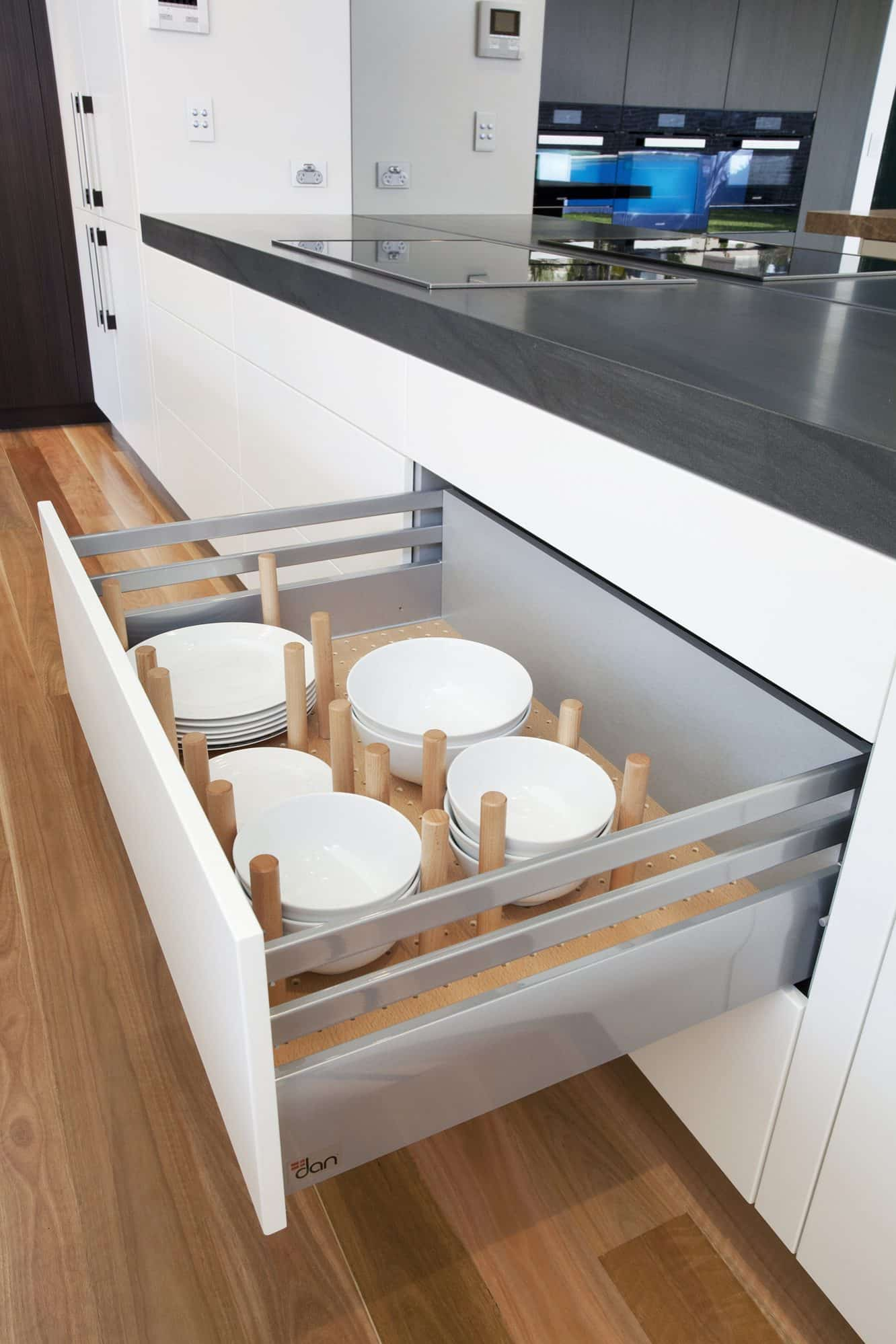 Wide drawer with timber pegs for dinnerware