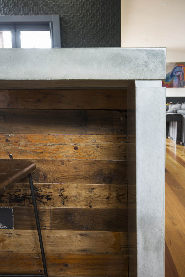 The bar back on the island has been crafted together using reclaimed timber.