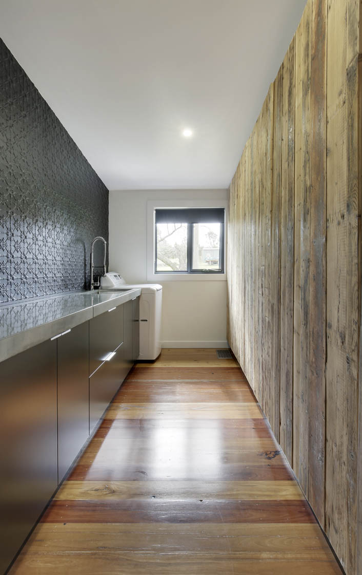 Laundry with black satin doors and reclaimed timber