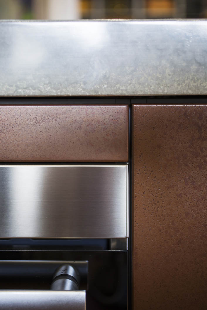 The industrial influence: Concrete is matched with pitted copper and brushed stainless steel