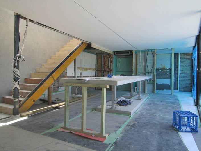 Concrete benchtop being made showing structural and temporary supports