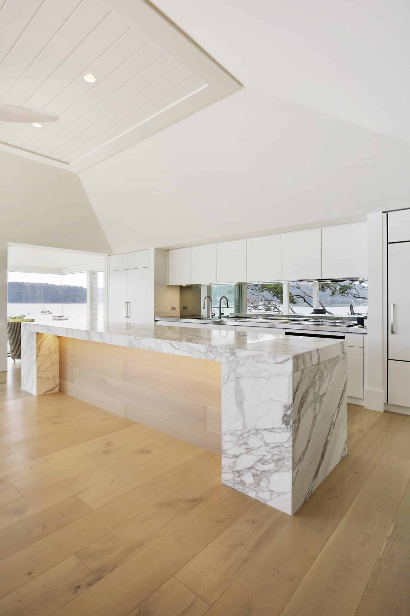 A striking kitchen island of calacatta marble