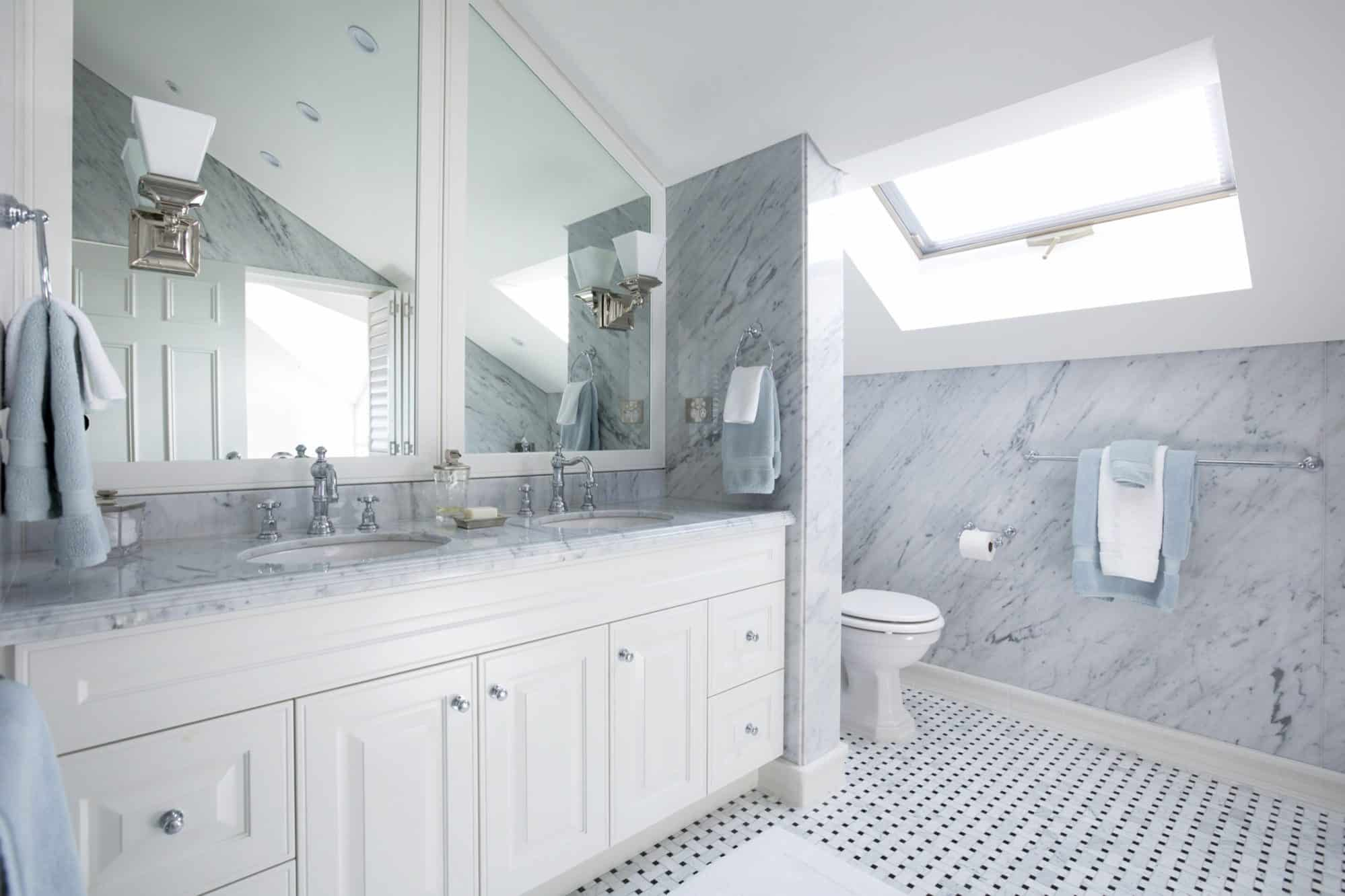 Carrara marble bathroom with art deco fittings