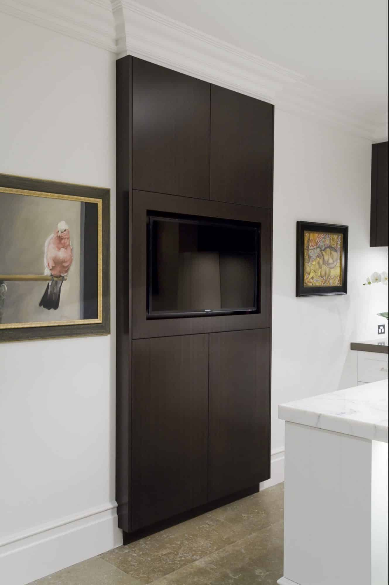 A TV is incorporated into the design of the kitchen