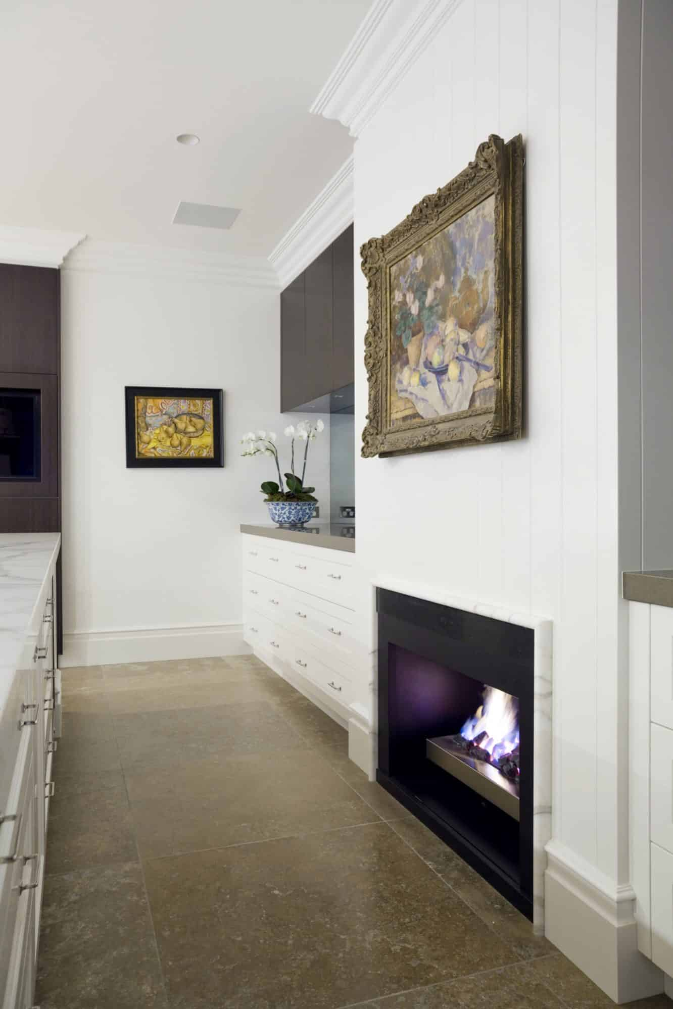 A fireplace is built into the design of the kitchen