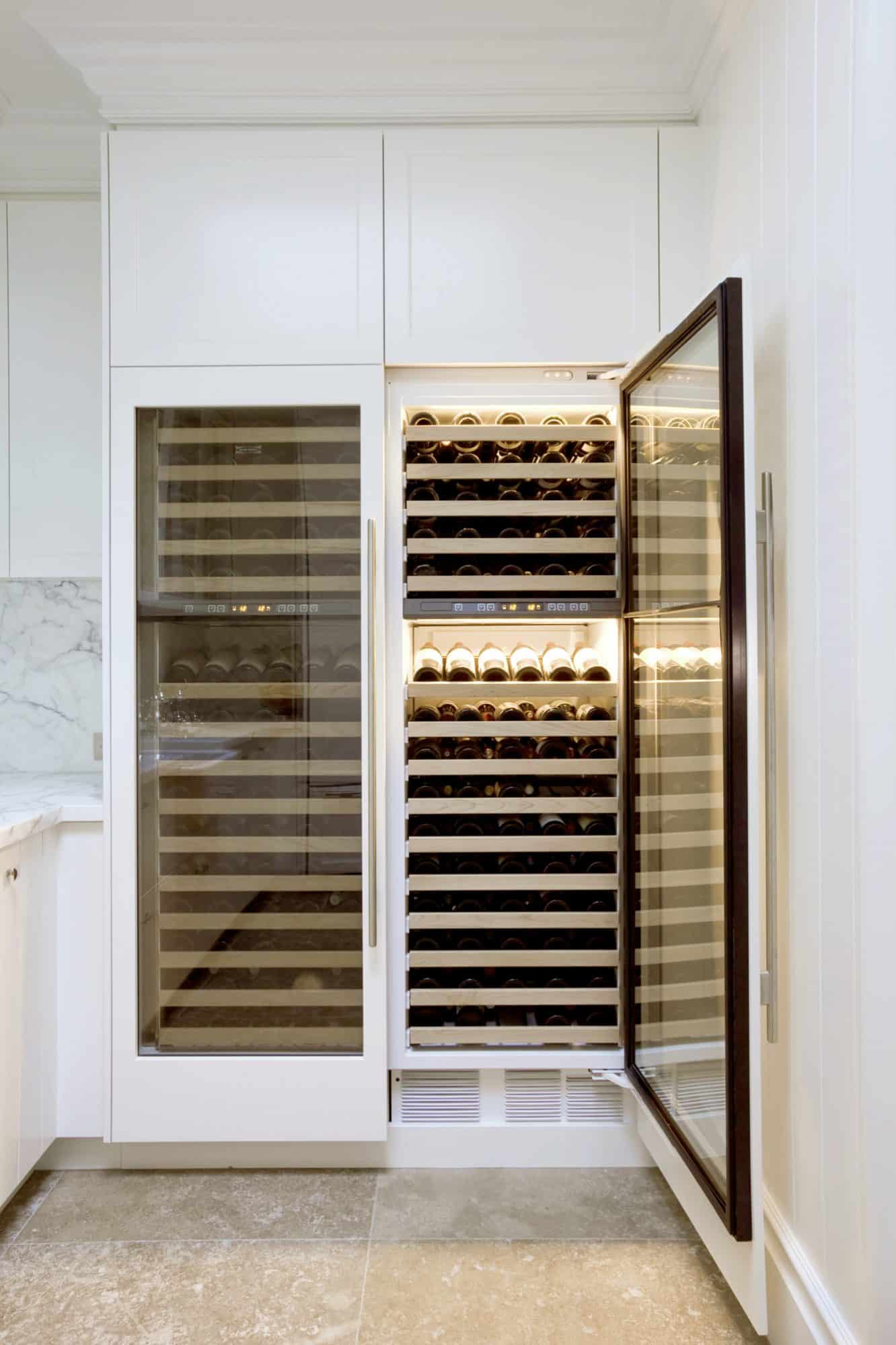 Two large Sub-Zero wine cabinets in a pigeon pair configuration