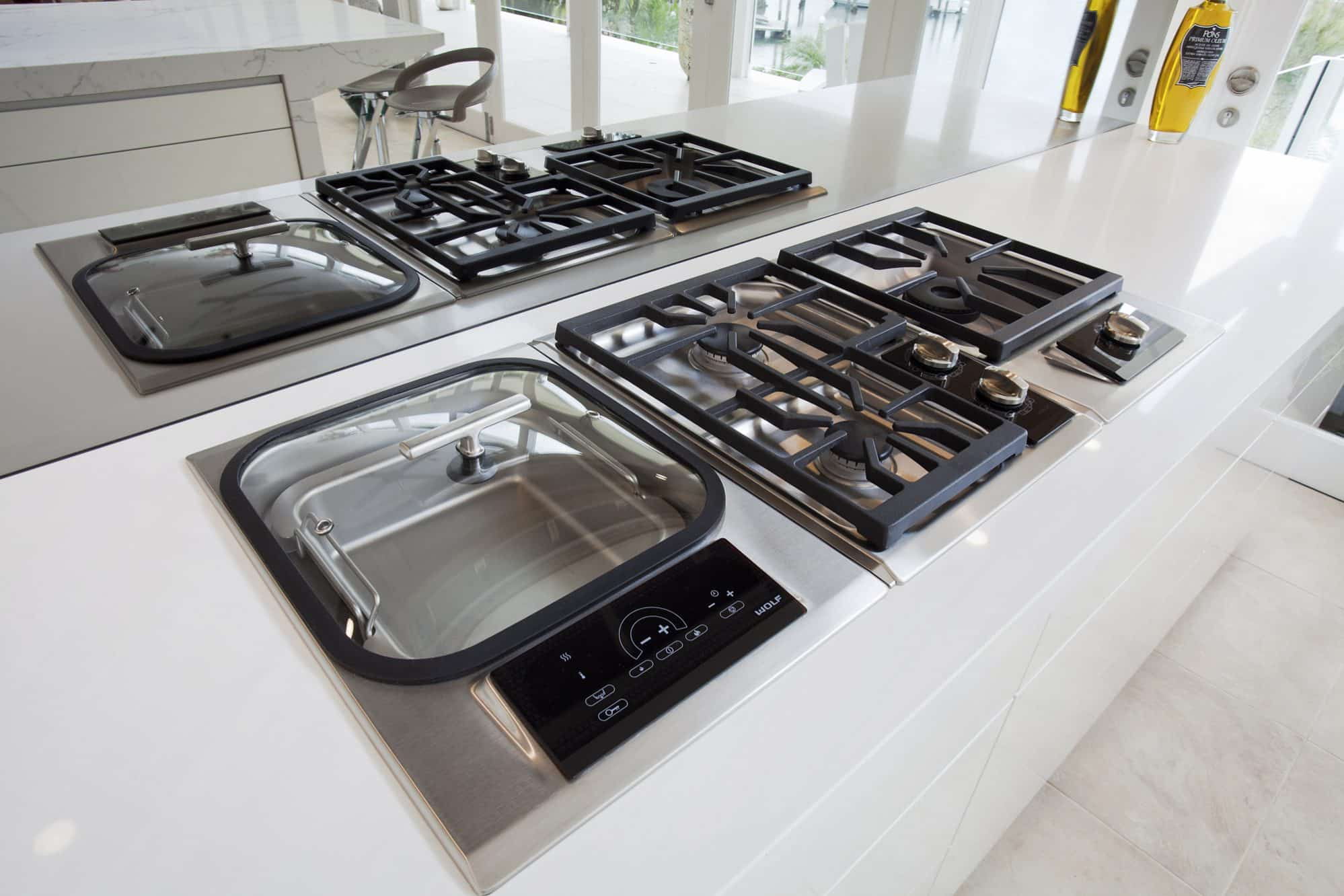 Wolf cooktop modules set within a white stone benchtop