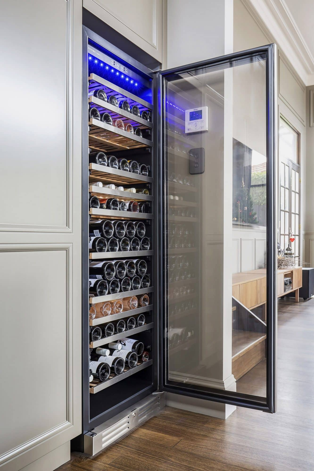 A tall Vintec Wine Storage cabinet